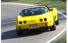 Gelbe Chevrolet Corvette C3 - Heckansicht