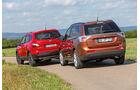 Mitsubishi Outlander 2.2 Di-D 4W, Nissan Qashqai +2 2.0 dCi, Heckansicht
