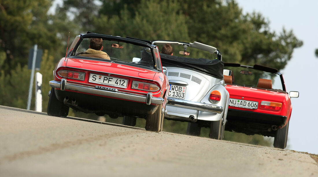 Peugeot 504 Cabriolet, Triumph Stag, VW 1303 Cabriolet Heckansicht